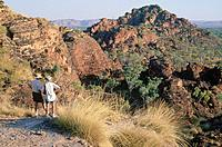 Kimberley Region. Hidden Valley National Park. Rock landscape. Trees. Man and woman walkers.