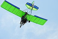 Ultralight aircraft low over field, Camarillo Airport, Camarillo California, USA