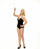 Attractive Caucasian woman wearing retro swimsuit in pinup pose with umbrella.