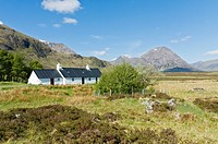 Black Rock Cottage Glencoe Highland Scotland with Buachille Etive Mhor in background