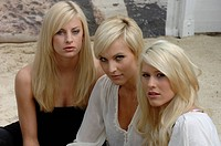 Three young blond women