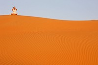 Meditation in the desert of Liwa, United Arab Emirates.