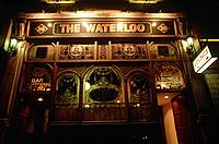 Exterior of Waterloo Pub/ bar at night. Signs Bar and Lounge. Engraved glass. Lights.
