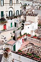 Aerial detail of ancient town of Matera with tufa houses, sunny spring afternoon, Puglia, Southern Italy,