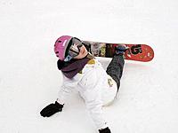 Teenage girl sitting in the snow on a ski slope of Vail Colorado
