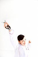 Cheerful doctor holding stethoscope