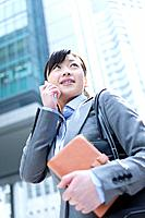 Businesswoman on mobile phone with address book