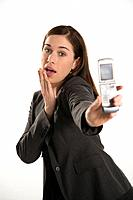 Caucasian mid adult professional business woman taking picture of self with camera phone with hand on chin.
