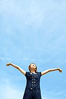 Woman with her arms raised to the sky