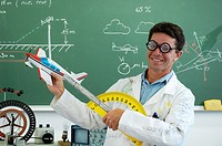 Funny school teacher explaining motorized flight with model plane