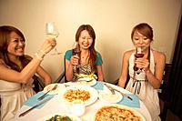 Young women eating dinner