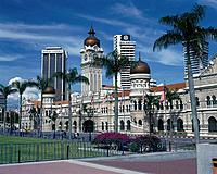 Sultan Abdul Samad Building. Moorish style. Onion domes. Keyhole arches. Padang. Grass.