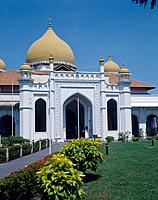 Georgetown. Majid Kapitan Kling mosque. White buildings with yellow domes. Garden