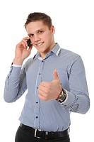 smiling young man talking on the phone