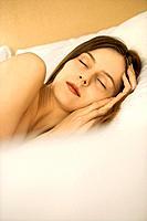 Caucasian mid_adult woman sleeping.
