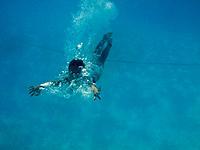 A child swims underwater.