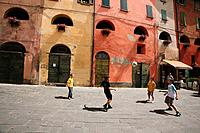 Children Playing Soccer In Street