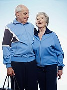Senior couple wearing tracksuits ready for sport