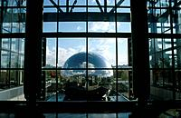 The Cite de Sciences science park complex and museum A spherical round building with a shiny reflective surface.