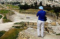 Archaeological site. Roman. South theatre. View from height. Man taking photograph. DwellingsHistorical _ ancient