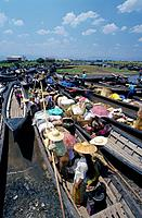 Ywama market. Waterway clogged with shallow long local boats. Laden with goods. People. MarketsScenics & landscapesGALLO