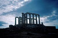 Temple of Poseidon. Silhouette of columns,stone arches. Against stormy cloudy sky.