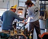 These two men artisans are creating live glass creating demonstrations during the Skagit Valley Tulip Festival held on April 2, 2010 in Skagit County,...