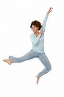 Pretty, Energetic Teenage Girl Leaping in the Air
