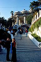 Parc Guell. Gaudi art,architecture. Steps up to fountain. Pillars. People.
