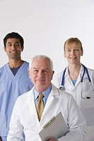 Portrait of three medical professionals, studio shot
