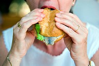 Woman eating a fish sandwich