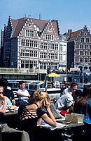 Canal,harbour. Cafe. People. View of large gabled merchant house.