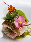 Mullet, green beans, salad, red chard leaves and edible flowers
