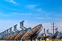 Concentrating solar power plant. Array of heliostats mirrors with sun_tracking motion at a concentrating solar power CSP plant. CSP plants use heliost...