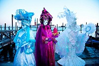 Three people in costume during Carnivale in Venice, Veneto, Italy