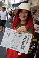 Japan, Tokyo, Tsukiji Fish Market, kanji, hiragana, characters, Asian, woman, employee, hostess, menu, restaurant, promoting, selling, announcing,