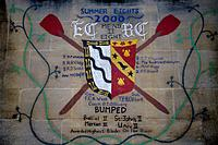 Exeter College. Image painted on wall. List of acheivements of Bumps,rowing races.