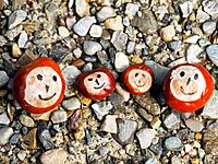 Happy family of four symbolized by conkers/chestnuts on the ground.