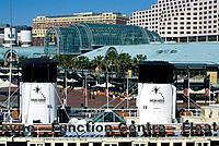 Darling harbour. Modern buildings,hotel. Boat,floating conference centre. Slogan Play It Your Way.
