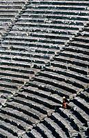 Epidaurus. Ancient theatre,amphitheatre. Built in 4th century BC. Still in use. Stone seats. One person.