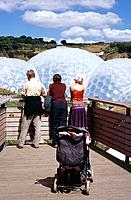 The Eden project is a environmental complexbuilt in a reclaimed clay pit in Cornwall. It was opened in 2001,and has two domes that house different env...