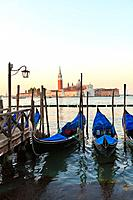 Gondolas moored on the Lagoon looking towards San Giorgio Maggiore, Venice, Veneto, Italy