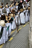 San Roque Children dressed in the garb of pilgrims marching through the streets of Llanes during the procession. Llanes, Asturias, Spain