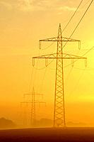 Electricity pylon at sunrise, Franconia, Bavaria, Germany