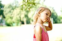 Young girl in pink in the park