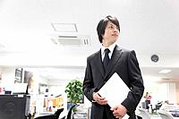 Young Businessman Standing in Office