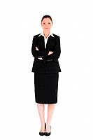 Beautiful female in suit posing while standing against a white background