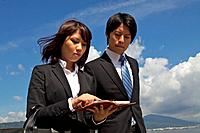 Business people walking outdoors, Shiga Prefecture, Honshu, Japan