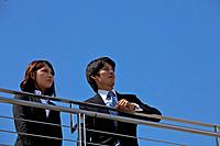 Business people on rooftop, Shiga Prefecture, Honshu, Japan