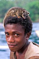 Young Man carry Marsupial on his Head, Vitu Islands, Bismarck Archipelago, Papua New Guinea